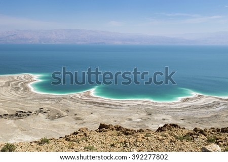 landscape of the Dead Sea, failures of the soil and the strong shallowing of the sea, illustrating an environmental catastrophe on the Dead Sea, Israel - stock photo