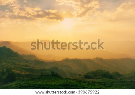 Landscape of the valley at sunset with mist - stock photo