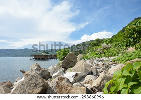Landscape of the volcanic caldera Lake Coatepeque in Salvador - stock photo