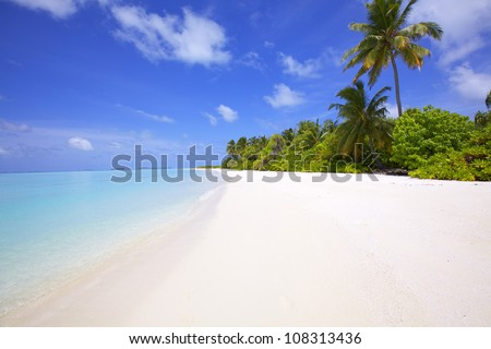 Landscape of tranquil island beach - stock photo