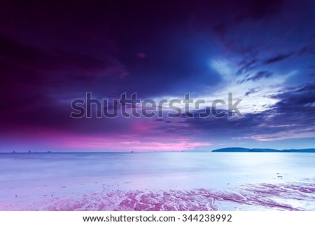 landscape of tropical beach and colorful sky at sunset in Krabi province, Thailand