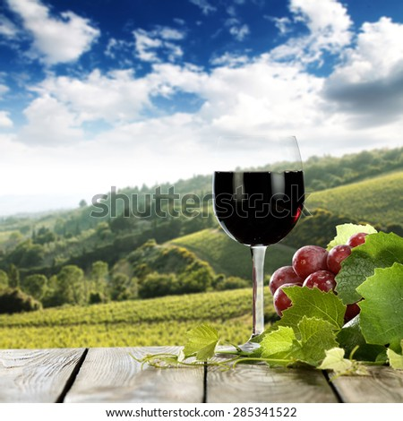 Landscape of Tuscany and  free space for your bottle and fruits on table  - stock photo
