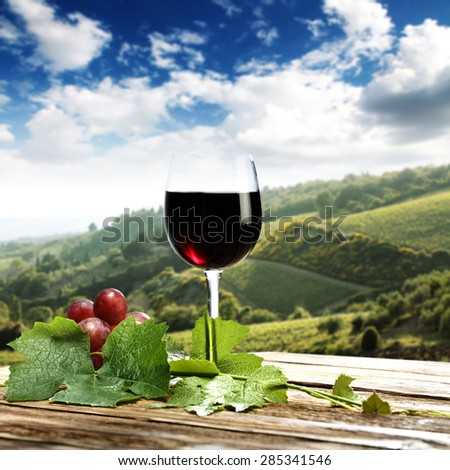 Landscape of Tuscany and fruits of grapes and wine