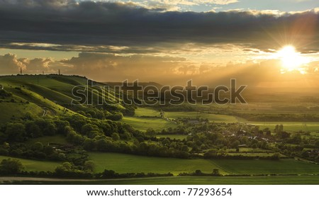 Landscape over English countryside landscape in Summer sunset - stock photo