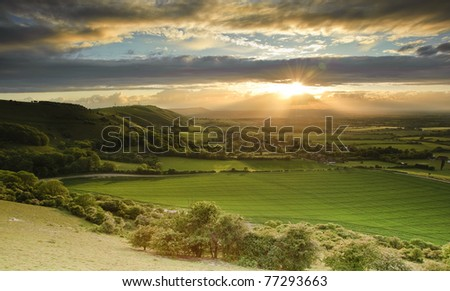 Landscape over English countryside landscape in Summer sunset
