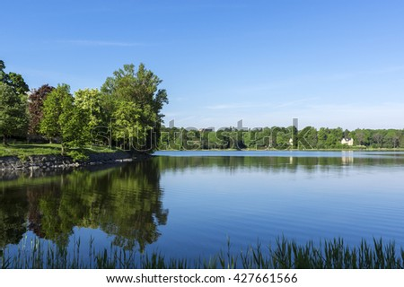 Landscape over lake and forest with blue sky