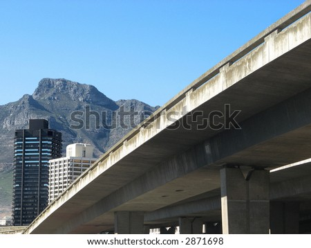 Landscape photo of a concrete overpass leading into Cape Town - stock photo