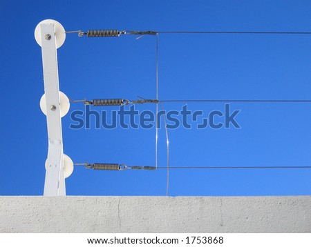 Landscape photo of an electrified fence junction. - stock photo