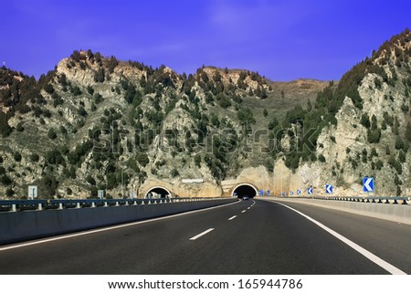 Landscape photo of Express highway in the mountain peak - stock photo