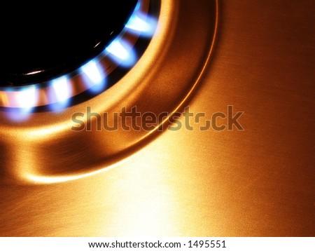 Landscape photo of single oven hob gas burner cropped to corner. - stock photo