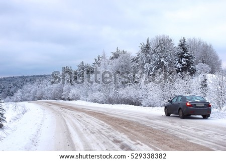 landscape Road in the winter forest with snow covered wilderness