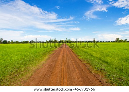Landscape road meadow countryside scenery beautiful background - stock photo