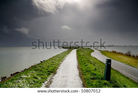 landscape scene in the netherlands with bad weather - stock photo