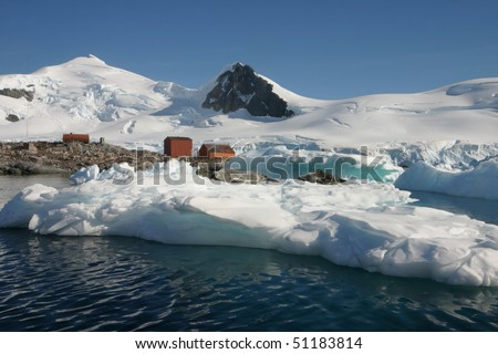 Landscape, Sea Leopards  and some old houses in Antarctica on a cloudless day - stock photo