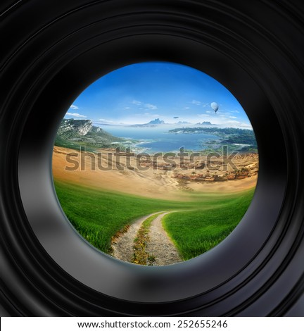 landscape seen through a door viewer - stock photo