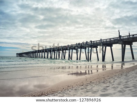 Landscape shot of fishing pier at Pensacola Beach, Florida at sunset. - stock photo