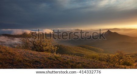 Landscape. Sunset over the mountains with clouds