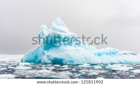 Landscape the iceberg of Neko Harbour, which was discovered by Belgian explorer Adrien de Gerlache in the early 20th century - stock photo