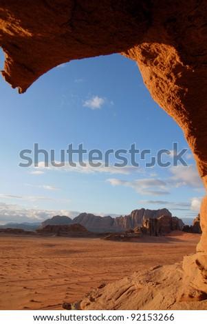 Landscape through a hole in the rock, Wadi Rum desert, Jordan - stock photo