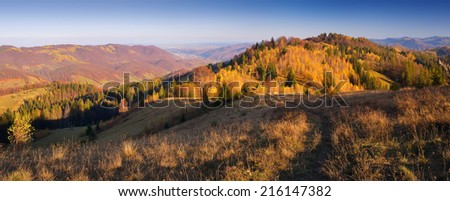 Landscape view of a sunny day. Beautiful Autumn in the village. Carpathian mountains, Ukraine, Europe - stock photo