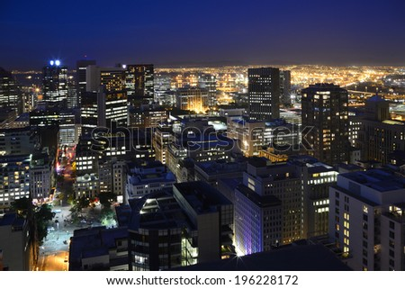 Landscape view of Cape Town's Central Business District taken on 23rd-May-2014 at night with buildings  illuminated. Image shot from an elevated viewpoint