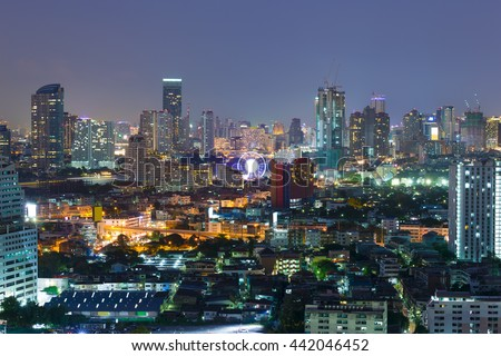 Landscape view of the residential and business district in Bangkok. Ferris wheel is an important point at night time.