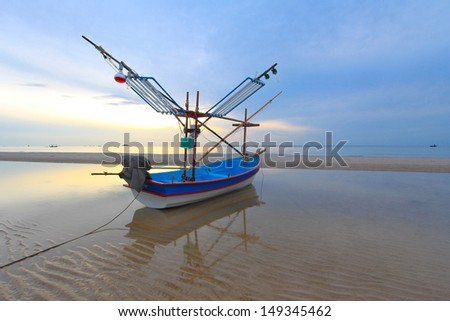 Landscape, vintage boats parked near the beach in the morning light - stock photo