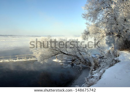 landscape winter morning on the river Zai - stock photo