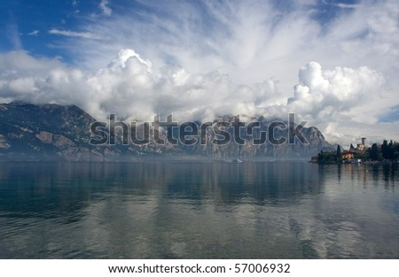 Landscape with a lake, mountains and clouds. - stock photo