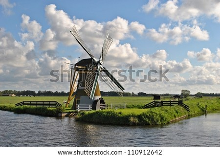 Landscape with a mill in The Netherlands. - stock photo