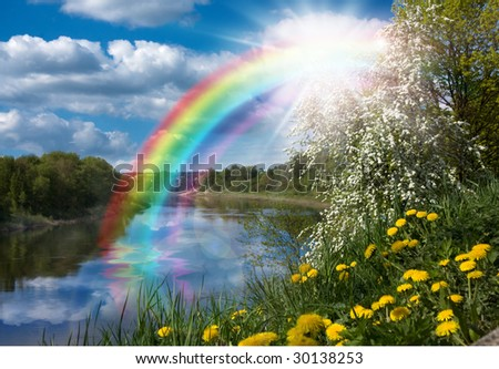 Landscape with a Rainbow on the River in Spring - stock photo