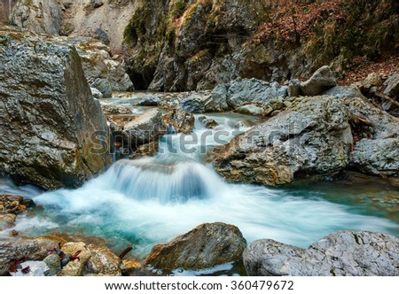 Landscape with a river in the mountains flowing rapidly - stock photo