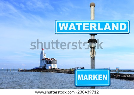 Landscape with a small lighthouse on seacoast (Marken. Netherlands) - stock photo