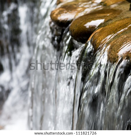 Landscape with a waterfall in a summer day. - stock photo