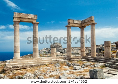 Landscape with ancient Roman time columns at Lindos in Greece.