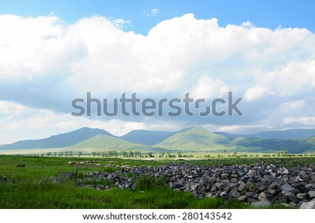 Landscape with ancient ruins and cumulus clouds - stock photo