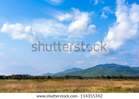 landscape with beautiful clouds and mountain views,  real scene without any light effects - stock photo