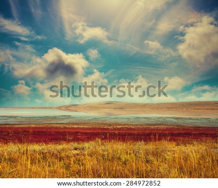 Landscape with beautiful cloudy sky and salt lake - stock photo