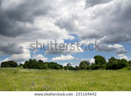 Landscape with cloudy sky before the thunderstorm.  - stock photo