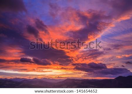 Landscape with cloudy sky on sunrise, Encartaciones, Bizkaia, Spain - stock photo