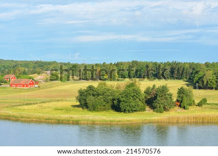 Landscape with farm on shores of Baltic Sea, Finland - stock photo