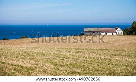 Landscape with field, house and sea. Bornholm