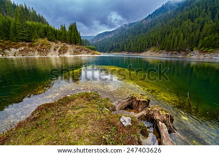 Landscape with Galbenu dam lake from Capatanii mountains in Romania - stock photo