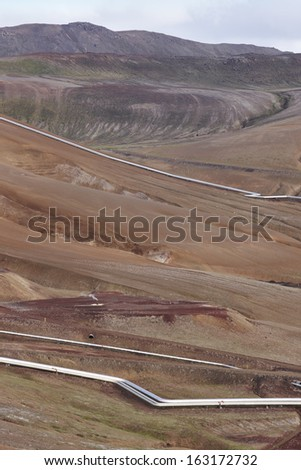 Landscape with geothermical pipes in Krafla area Iceland vertical image