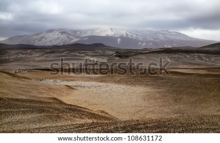 Landscape with Hekla volcano and dramatic clouds. Southern Iceland. - stock photo