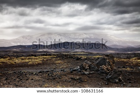 Landscape with Hekla volcano and dramatic sky. Southern Iceland.