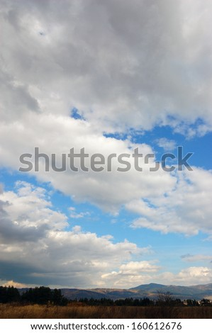 Landscape with hills and clouds