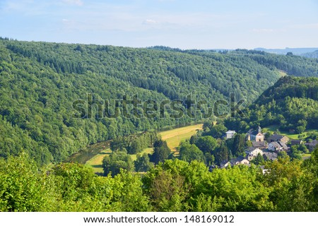 Landscape with hills and river near Kermesse Rochehaut in Walloon, province Namur in Belgium in a calm summer day