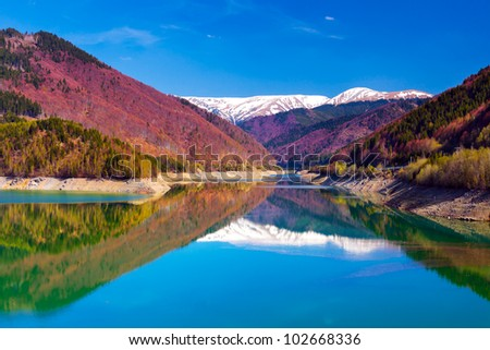 Landscape with lake and mountains - stock photo