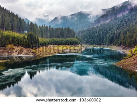 Landscape with lake Galbenu in Parang mountains in Romania - stock photo